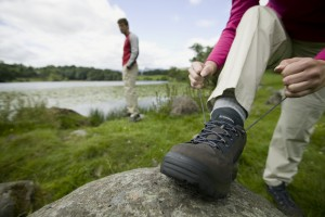 Woman tying her boot laces by Loughrigg Tarn Crag Hoppers Shoot 2006