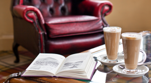 Close-up of a coffee and book on a table in the lounge